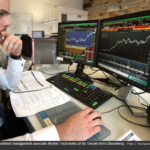 Avenue investment management associate Bryden Teich works at his Toronto firm's Bloomberg terminal