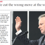 Clipping of front page of news article featuring a man waving from a podium.